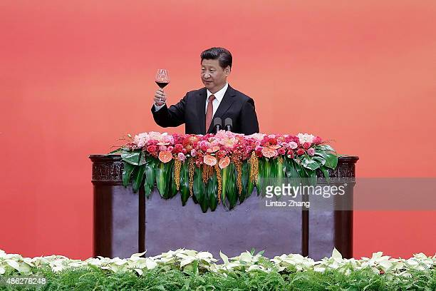 Chinese President Xi Jinping toasts the guests after delivering a speech during the Reception Commemorating the 70th Anniversary of the Victory of...