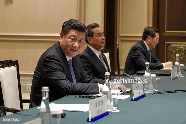 Chinese President Xi Jinping waits before his speech with the Japanese delegation led by Japanese Prime Minister Shinzo Abe at their meeting at the...