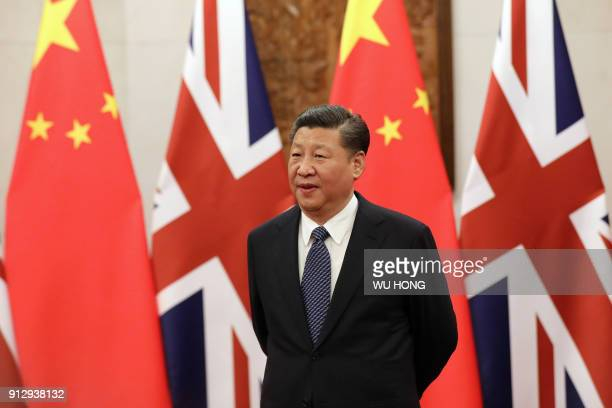 Chinese President Xi Jinping waits for British Prime Minister Theresa May ahead of their meeting at the Diaoyutai State Guesthouse in Beijing on...