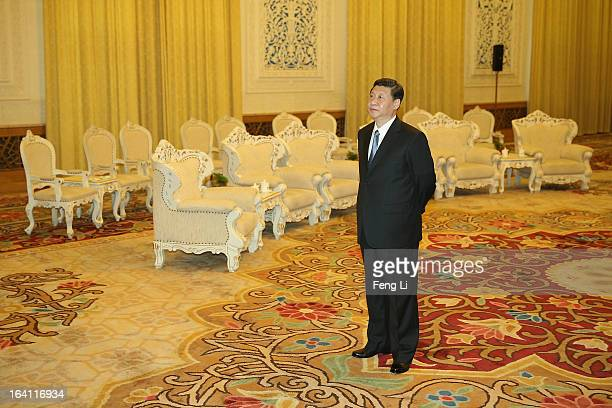 Chinese President Xi Jinping waits for meeting US Secretary of Treasury Jacob Lew during his visit to the Great Hall of the People on March 19 2013...