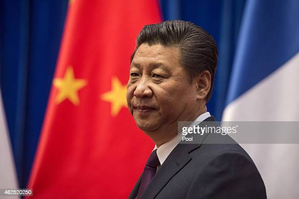 Chinese President Xi Jinping waits to welcome French Prime Minister Manuel Valls at the Great Hall of the People on January 30 2015 in Beijing China...