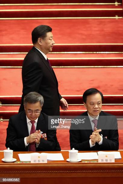 Chinese President Xi Jinping Walk through Vice Premier Hu Chunhua and Chen Miner secretary of the Chongqing Municipal Party Committee and member of...