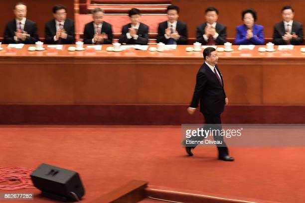 Chinese President Xi Jinping walks during the opening session of the 19th Communist Party Congress held at the Great Hall of the People on October...
