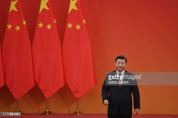 Chinese President Xi Jinping walks off the stage after his speech during an award ceremony in Beijing's Great Hall of the People on September 29 2019...