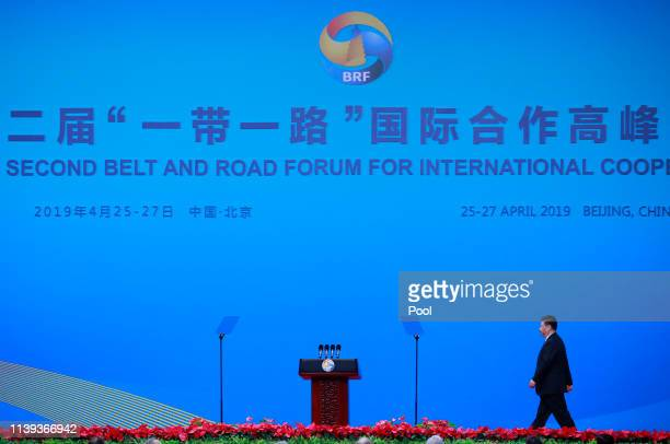 Chinese President Xi Jinping walks on stage to deliver his speech for the opening ceremony of the Belt and Road Forum for International Cooperation...