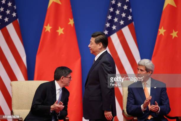 Chinese President Xi Jinping walks past US Secretary of Treasury Jack Lew and US Secretary of State John Kerry as he makes his way to deliver a...