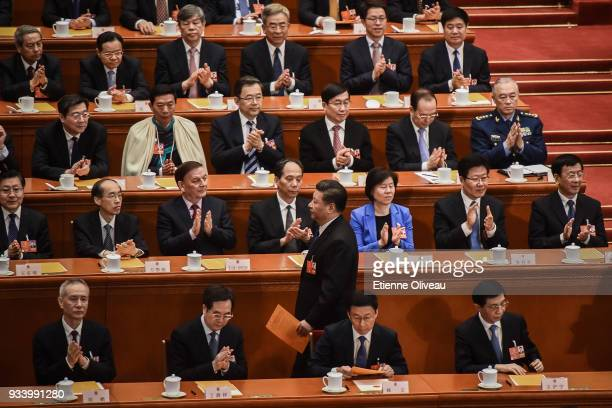 Chinese President Xi Jinping walks to cast his vote during the seventh plenary session of the 13th National People's Congress at the Great Hall of...