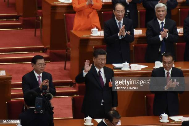 Chinese President Xi Jinping waves to the attendees with Chinese Premier Li Keqiang and member of the Communist Party of China's Politburo Standing...