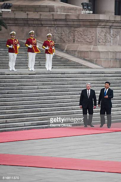 Chinese President Xi Jinping welcomes German President Joachim Gauck at the Great Hall of the People on March 21, 2016 in Beijing, China. At the...