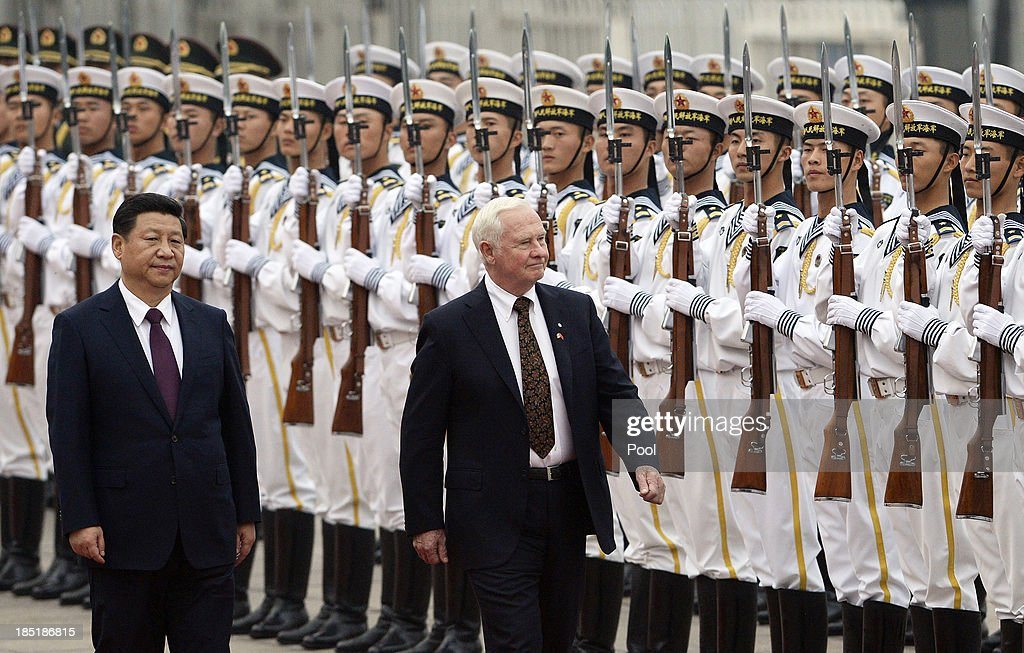 Chinese President Xi Jinping (L) welcomes Governor General David Johnston of Canada at the Great Hall of the People on October 18, 2013 in Beijing, China.