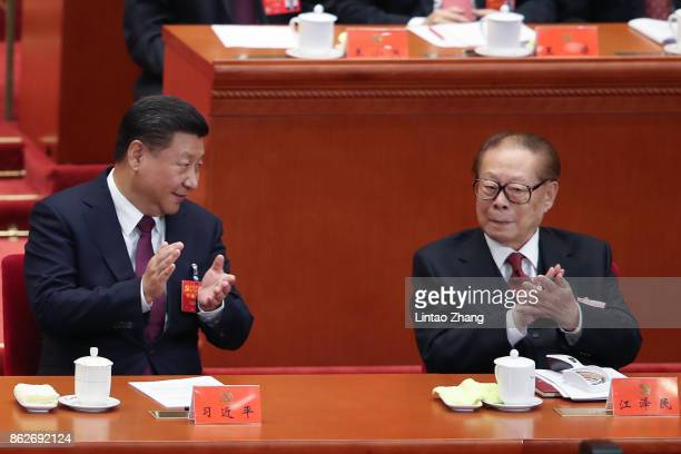 Chinese President Xi Jinping with China's former president Jiang Zemin at the opening session of the Chinese Communist Party's Congress at the Great...