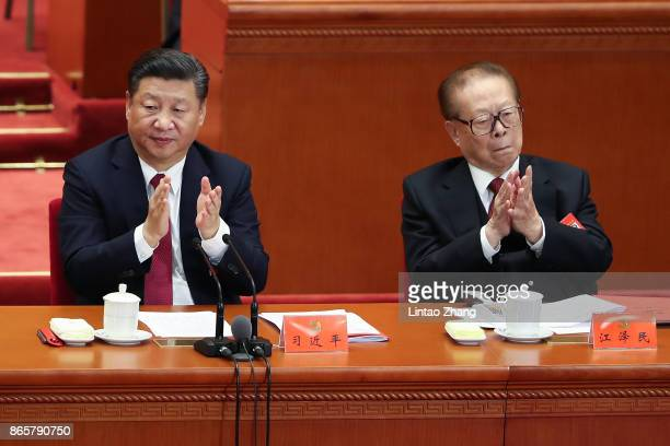 Chinese President Xi Jinping with China's former president Jiang Zemin attends the closing of the 19th Communist Party Congress at the Great Hall of...