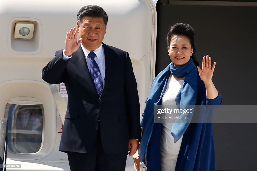 Chinese President Xi Jinping with chinese Lirst Lady Peng Liyuan arrive at Hamburg Airport for the Hamburg G20 economic summit on July 6, 2017 in Hamburg, Germany. Leaders of the G20 group of nations are meeting for the July 7-8 summit. Topics high on the agenda for the summit include climate policy and development programs for African economies.