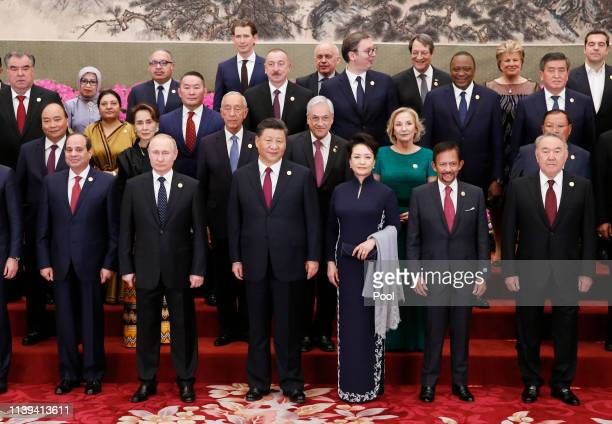 Chinese President Xi Jinping with his wife Peng Liyuan Russian President Vladimir Putin and other leaders attend a group photo session at a welcoming...