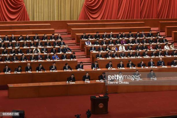 Chinese President Xi Jinping , with other officials, cast his vote during the seventh plenary session of the 13th National People's Congress at the...