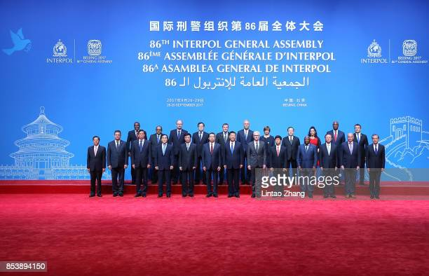 Chinese President Xi Jinping with Secretary General Interpol Jurgen Stock and Meng Hongwei president of Interpol pose for a group photo before the...