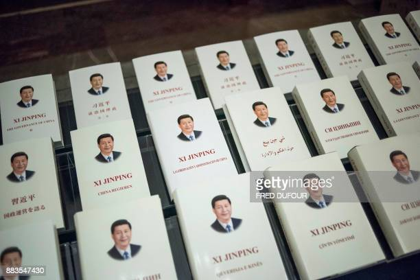 Chinese President Xi Jinping's book translated into foreign languages is on display during the opening ceremony of a highlevel meeting held by the...