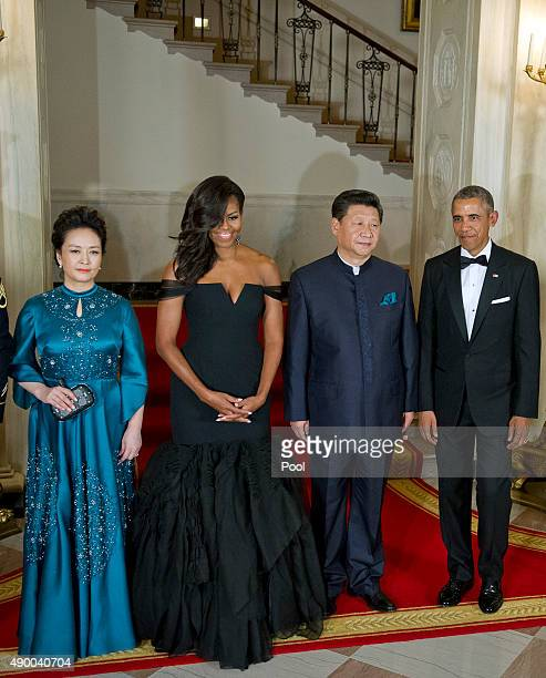 Chinese President Xi Jinping's wife Peng Liyuan first lady Michelle Obama Chinese President Xi Jinping and President Barack Obama pose for a formal...