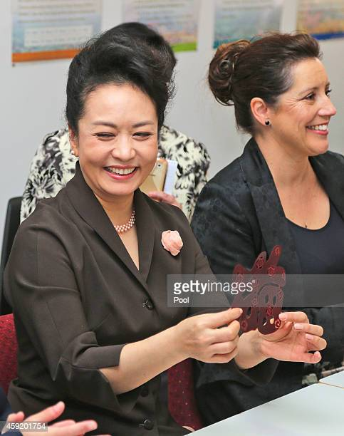 Chinese President Xi Jinpin's wife Madame Peng Liyuan shows here paper cutout during their lessons in Mandarin calligraphy papercutting and...