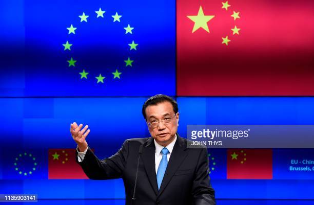 Chinese Prime Minister Li Keqiang gestures as he speaks during a joint press conference with the European Commission and European Council presidents...