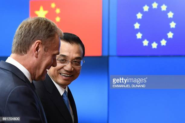 Chinese Prime Minister Li Keqiang is welcomed by European Council President Donald Tusk at the European Council in Brussels on June 1 2017 ahed of a...