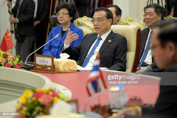 Chinese Prime Minister Li Keqiang speaks as Thai Prime Minister Prayuth ChanOCha listens during the second MekongLancang Cooperation Leaders' Meeting...