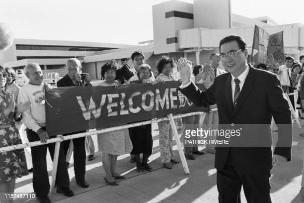 Chinese Prime Minister Li Peng is welcomed by the Perth Chinese community on his arrival for his official visit in Australia on November 14, 1988 at...