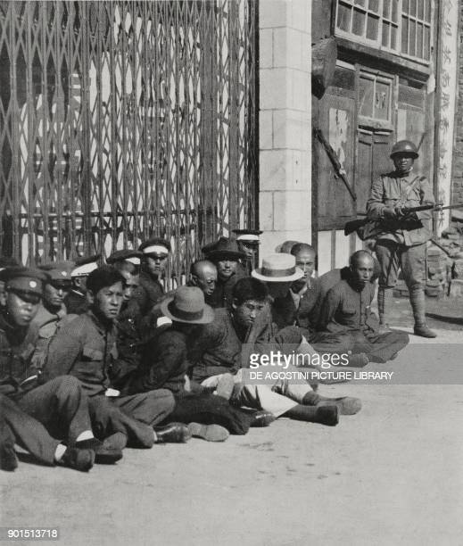 Chinese prisoners guarded by a Japanese soldier after the Japanese occupation of the Manchuria region, Mukden , China, from L'Illustrazione Italiana,...