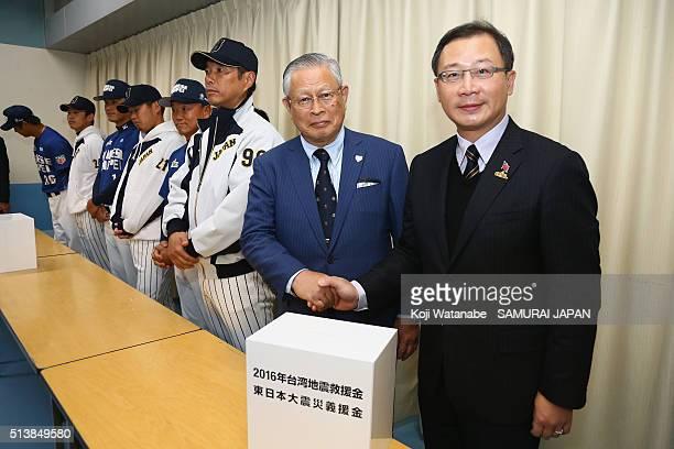 Chinese Professional Baseball League Commissioner John Wu and Nippon Professional Baseball Commissioner Katsuhiko Kumazaki shake hands prior to the...
