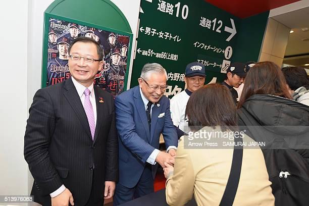 Chinese Professional Baseball League Commissioner John Wu and Nippon Professional Baseball Commissioner Katsuhiko Kumazaki shake hands with baseball...