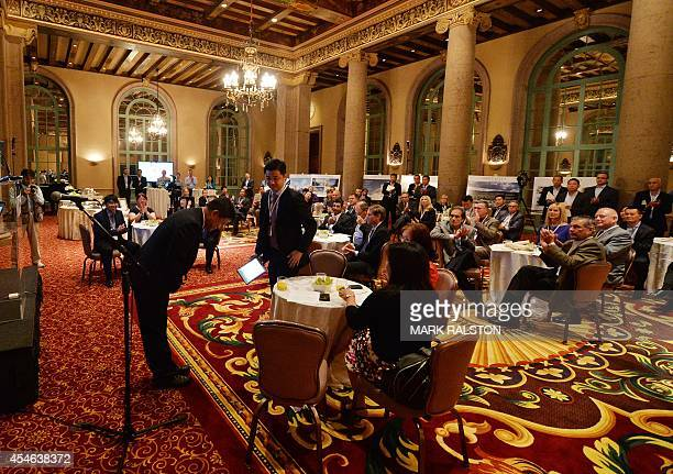 Chinese property tycoon Tian Ming founder and chairman of Landsea Holdings Corporation bows to his audience at the historic Biltmore Hotel in Los...