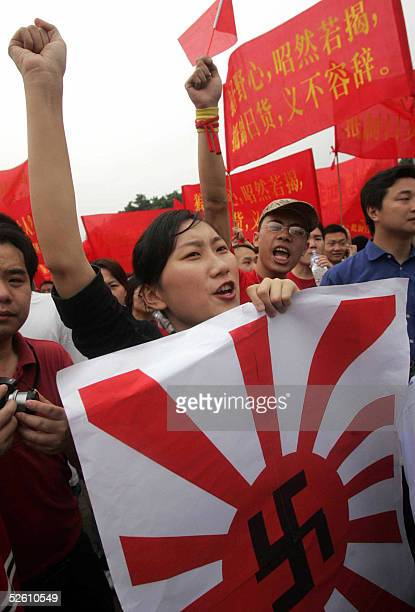 Chinese protesters demonstrate against Japan's dealing with its wartime past 10 April 2005 in Guangzhou southern China Around 20000 antiJapanese...