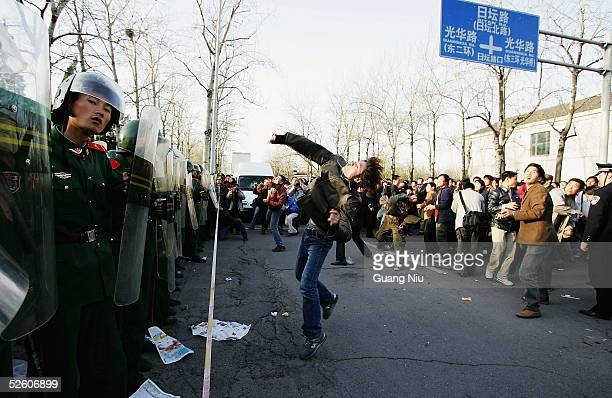 Chinese protesters hurl stones at the Japanese Embassy during an antiJapanese demonstration on April 9 2005 in Beijing China Up 10000 demonstrators...