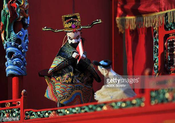 A Chinese puppet or Wayang Po Te Hi performance is seen at a mall in Jakarta on January 22 2012 A troupe of lion dancers jerk and sway down a busy...