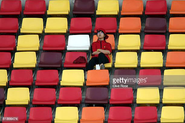 Chinese race fan watches the action alone in the grandstand during the Practice session prior to Qualifying for the Formula One Chinese Grand Prix at...