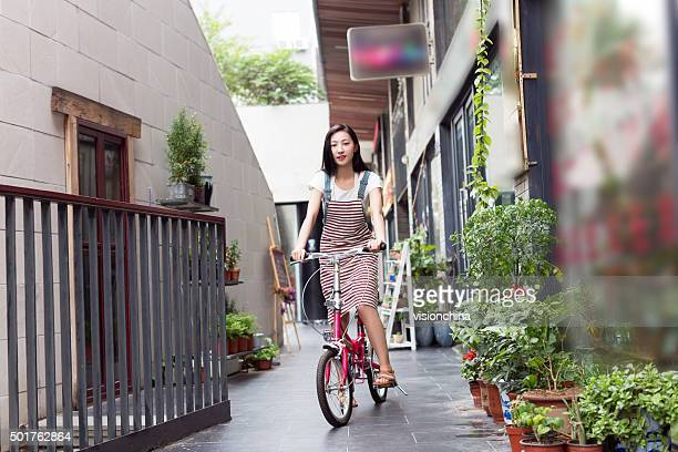 chinese rapunzel riding a bicycle