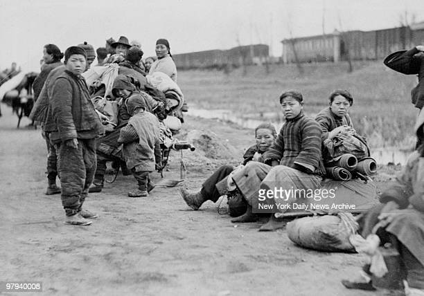 Chinese refugees of SinoJapanese War on road from Chapei to safety of International Settlement