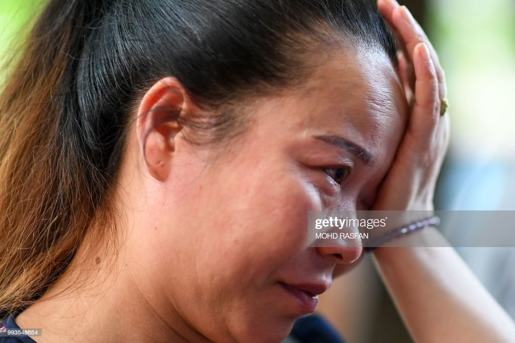 A Chinese relative cries at the Vachira Phuket Hospital in Phuket on July 8, 2018, after a tourist boat carrying 105 passengers, mostly Chinese tourists, capsized in rough seas on July 5. - Recovery divers have pulled 41 bodies from the sea off the Thai holiday island of Phuket, officials said on July 7, 48 hours after a boat capsized in rough waters killing dozens of Chinese passengers.