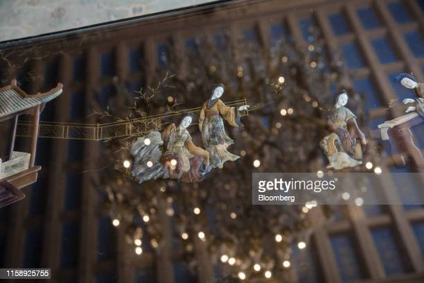 A Chinese relief decorates a polished table reflecting a crystal chandelier inside the Villa Les Cedres a 187yearold000squarefoot 14bedroom mansion...