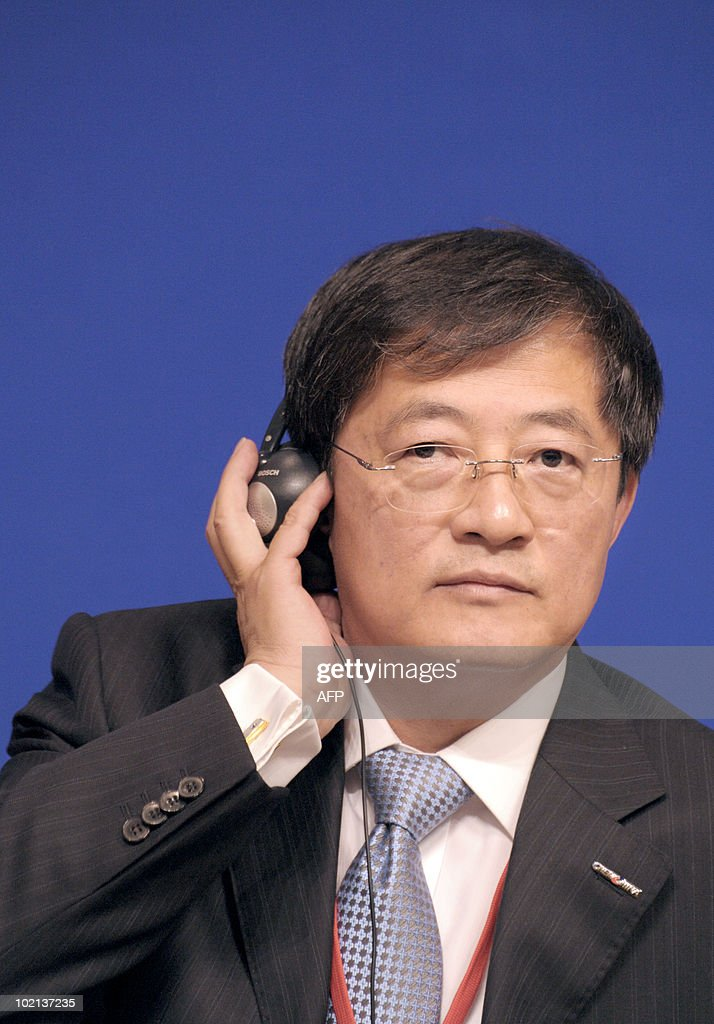 Chinese Ren Jianxin, Chairman of ChemChina (L) listens to a speaker on June 16, 2010 in Paris during the symposium 'Europe/China: Facing our common challenges' organised in Paris by the French directorate-general of the Treasury.