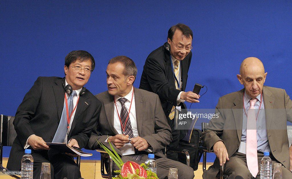 Chinese Ren Jianxin, Chairman of ChemChina (L) listens to French President and Chief Executive Officer Jean-Pascal Tricoire (2ndL) of French group Schneider Electric flanked by Chinese Frankie Wong, Vice Chairman of Shui On Construction & Materials ltd (standing 2ndR) and French Chief Executive Officer of EADS Louis Gallois (R), on June 16, 2010 in Paris at the symposium 'Europe/China: Facing our common challenges' organised in Paris by the French directorate-general of the Treasury.