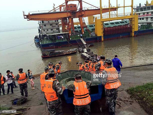 Chinese rescue team head out to search for survivors of a passenger ship carrying more than 450 people which sunk in the Yangtze river triggering a...