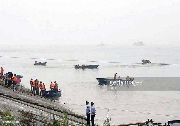 Chinese rescue teams head out to search for survivors of a passenger ship carrying more than 450 people which sunk in the Yangtze river triggering a...