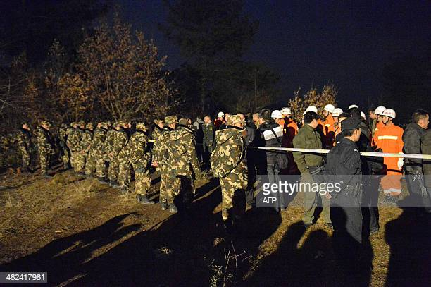 Chinese rescuers guard a closed area after an explosion in the Laoshan village of Kaili in southwest China's Guizhou province on January 13 2014 An...