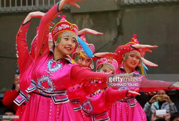 Chinese residents in Japan perform folk dance to celebrate Chinese Lunar New Year at Yokohama Chinatown in Yokohama suburban Tokyo on January 29 2017...