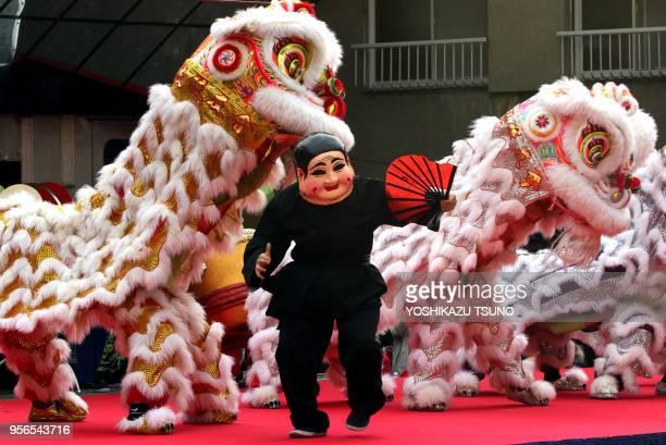 Chinese residents in Japan perform lion dance to celebrate Chinese Lunar New Year at Yokohama Chinatown in Yokohama suburban Tokyo on January 29 2017...