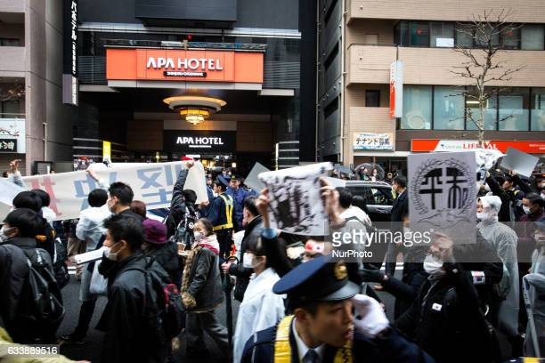 Chinese residents in Tokyo walk with placards to protest against the APA hotels amp Resorts in Tokyo Japan Feb 5 2017 China has lodged a complaint...