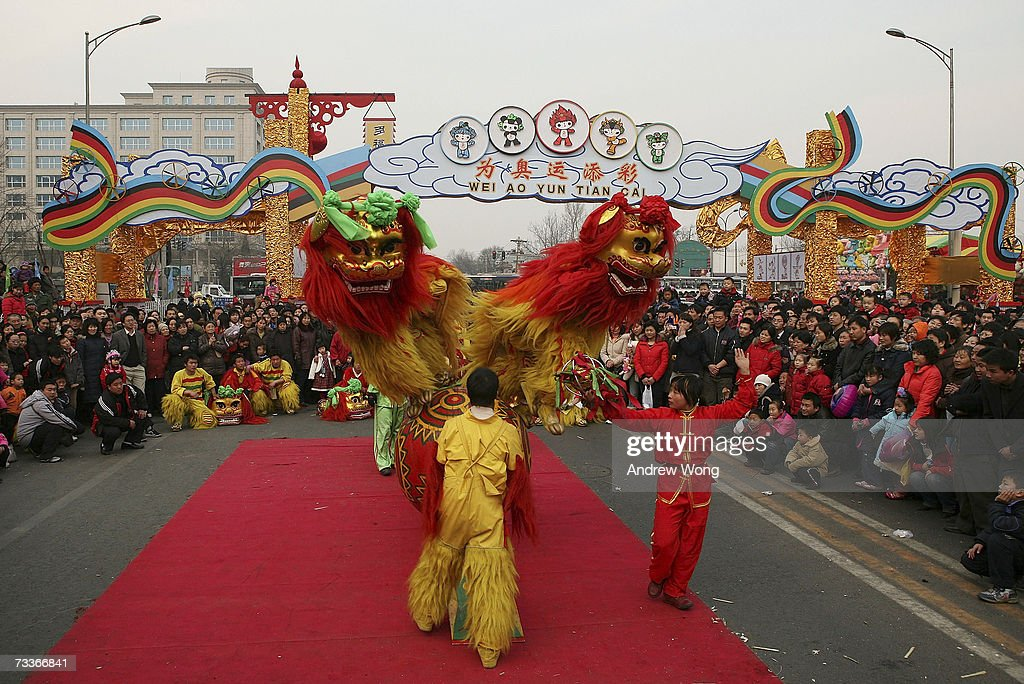 chinese revellers watch a traditional lion dance at a temple fair to mark the chinese new - Chinese New Year 2007