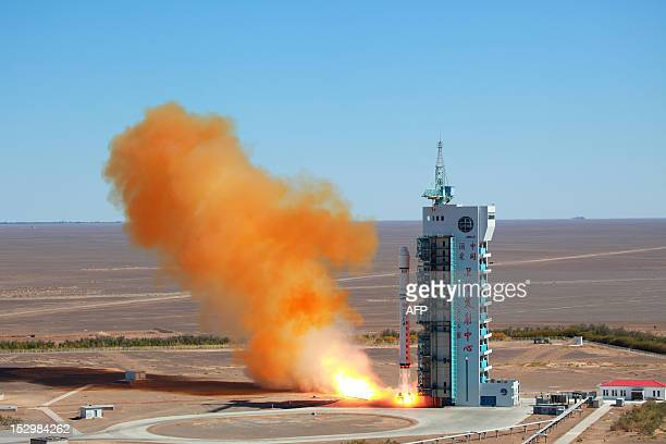 A Chinese rocket takes off with the Venezuelan earth observation satellite Miranda from the remote Gobi desert in Jiuquan northwest China's Gansu...
