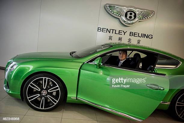 Chinese sales representative sits in a new Bentley luxury car at a showroom on January 27 2015 in Beijing China Sales grew globally for the luxury...